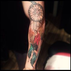 Beautiful delicate looking feathers on this dream catcher tattoo .@victormontaghini
