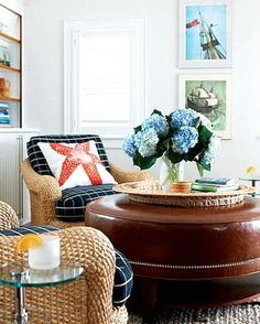 Bring on the bold colors with pillows and art (and flowers).