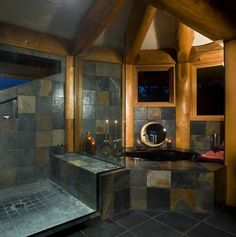 Found my perfect bathroom! Wood and stone design with waterfall shower and jacuzzi. Amazing.