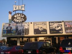 "World Famous V.I.P. Records, Long Beach, CA. Now shuttered, unfortunately. Was a liquor store called Whistlers, long ago--and the man on the sign was originally ""whistling."" Awesome, amazing reuse of a sign, and a great store."