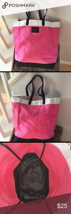 Extra Large Victoria's Secret Pink Beach Bag 🏖🏝 Extra large Victoria's Secret pink beach bag. Color block unlined tote bag with photo leather handles in the colors pink, black, and white. Canvas. Huge gorgeous bag. Great condition except for the following which I have included photos of: mark on the white top part, faint barely noticeable mark on the pink part, and a few loose threads near the bottom corner. 🏖🏝 Victoria's Secret Bags Totes