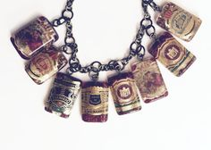 A new creative path...cigar bands and resin. Cigar band art charm necklace by MaryClaires on Etsy