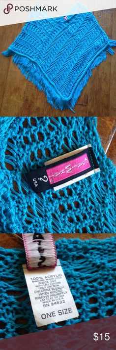 Say What? Turquoise open crochet poncho one size Super cute, pullover, turquoise blue, poncho with fringe. Great over tee or tank. Perfect for bonfires, chilly theaters, walks outdoors. Great with pants, jeans, shorts and skirts.  Worn just a few times, excellent condition. Tops