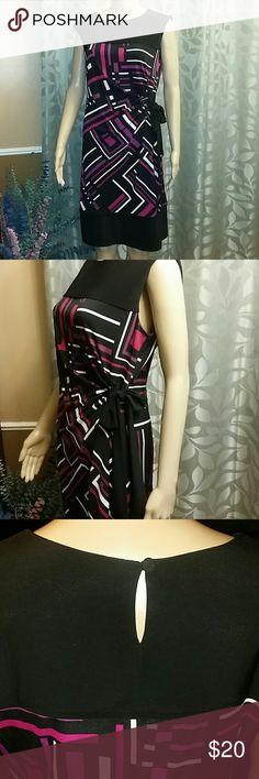 Karin Stevens Dress Very flattering  Sleeveless  Side tie  96 % polyester  4 % spandex  Like new Worn twice Karin Stevens Dresses