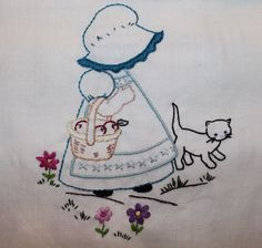 Hand embroidered Sunbonnet Sue with kitten.  I  had her embroidered on the back of a shirt loved it