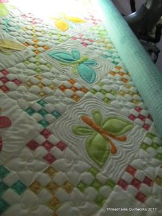 love the simple but sweet quilting in the 9-patch blocks
