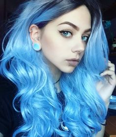 Curly long blue dyed hairstyle - http://ninjacosmico.com/28-crazy-hairstyles-ideas/