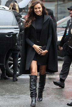 Ravishing Russian:  Irina Shayk donned an all black ensemble including a chic cloak over a...