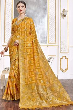 Turmeric Yellow viscose saree with turmeric yellow viscose blouse. Embellished with woven zari work. Saree with Sweetheart Neckline, Half Sleeve. It comes with unstitch blouse, it can be stitched to 32 to 58 sizes. #weddingsaree #weddingwearsaree #festivalwear #partywearsaree