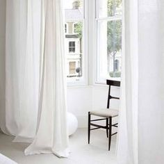 white curtains for bay window