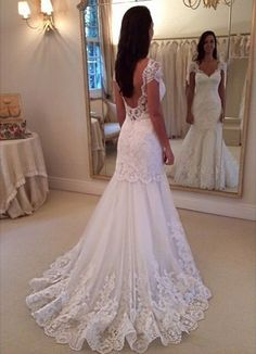 This backless lace wedding dress has short cap sleeves. When you have a dress design firm like us create your custom wedding dress we can make any change you need to a design.  We can work from any pictures you have. So if your #dreamweddingdress is out of your price range or discontinued contact us.  We can recreate it for you in a price range you can afford. See other options for custom wedding dresses when you visit us at www.dariuscordell.com/