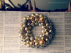 Love this #mixedmetal DIY holiday wreath from Composing Justice. The sheet music doesn't hurt either!