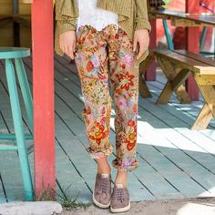 "LAILANI PANTS -- A pair of elastic drawstring-waist floral pants comfortable enough for lounging by the pool, and vibrant enough to wear on the town. Relaxed fit. Cotton. Machine wash. Imported. Catalog exclusive. Sizes XS (2), S (4 to 6), M (8 to 10), L (12 to 14), XL (16). 25"" Inseam"