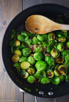 Delicious and easy bacon brussel sprouts recipe sautéed with garlic, olive oil, salt, pepper, and grated parmesan cheese.