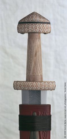 """Viking sword cooper and silver inlay hilt, pattern-welded blade, handle from horn. This replica can be found on the exhibition """"The viking grave from Groix island"""". 9th Century. Nantes France."""