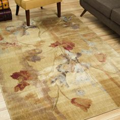 With a warm palette of green, red, blue, ivory, and beige, this lovely floral area rug by Summerfield is a stylish addition to any home. The rug is crafted of Opulon polyacrylic, measures 5.5 feet by 7.4 feet, and has a pile height of 0.50 inches.