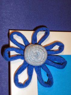 Altrapo. Marcos de foto adornado con flor de trapillo.