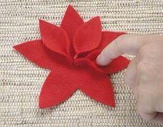 Non è necessario essere delle esperte di ago e filo per realizzare una stella di Natale di pannolenci tridimensionale