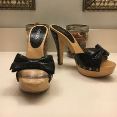 Guess Veronica Wood Mule with bow Pin Up style wooden mule with bow detail.   Faux patten leather patch on heel with rivets. Five inch heel 1 1/2 inch platform.   Guess Veronica.   Never worn out - virtually flawless. Guess Shoes Mules & Clogs