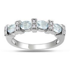 "<li>Oval-cut blue topaz and diamond stackable  jewelry</li><li><a href=""http://www.overstock.com/downloads/pdf/2010_RingSizing.pdf""><span class=""links"">Click here for ring sizing guide</span></a></li>"