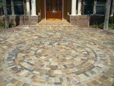 A different way to do a circle patio, with rectangle pavers making a circle every circle or two. It changes it up and gives it a nice look.