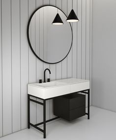 MILANO, bathroom collection of CIELO, design by Andrea Parisio and Giuseppe Pezzano,made up of the innovative large ceramic washbasin with a large basin and a convenient top built into a cabinet with an attached storage drawer, all shown in the Talco finish. The steel structure is  in a matte black finish and the drawers are black oak. #interiordesign #HandMadeinItaly #ceramic #inspiration #bathroomdesign #washbasin #ceramicacielo