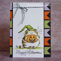 handmade Halloween card from A Scrapjourney ... delightful cat holding a Jack-O-Lantern ... great layout ... fishtail stripes on black background ... great card!!