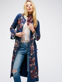 Fleur Du Jour Jacket | A beautifully bohemian jacket with an open, effortless design featuring a tribal-inspired print with stunning floral embroidery throughout. Retro-inspired flred sleeve cuffs and lovely lace-up side details complete the look. Dramatic side vents create a unique silhouette. Lined. $268