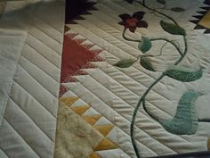 It took 2 years for Eileen Dierck to piece and applique all the flowers and vines plus add hand embroidery on this quilt top. The pattern i...