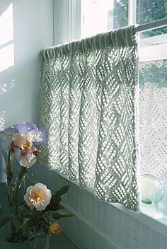 Pattern instructions in free download. This lacy curtain allows you to enjoy the beauty of daylight and still maintain your privacy. A slightly loosened gauge gives the lace an airy quality, while the smooth cotton blend yarn knits into a crisp and attractive fabric.