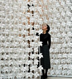 Art Installation of Windmills spinning windmills art Lebanese designer Najla El Zein has installed 5000 spinning paper windmills in a doorway at the V&A museum in London. Each of the spinning windmills in the Wind