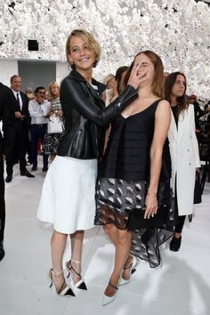 Jennifer Lawrence and Emma Watson attend the Christian Dior show as part of Paris Fashion Week - Haute Couture Fall/Winter 2014-2015 at Muse...