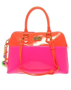 not typically a fan of patent leather, but my love for neon red-orange and pink out-weighs my distrust of patent leather! this bag is winning my heart over!