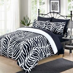 Digitally printed zebra skin texture in dis superior sateen quality bed set features a dual-side printed duvet allowing you teh benefit of two-in-one bedding.