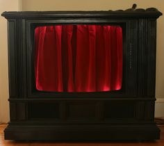 Picture #3 (LED rope lights were added into the interior, which, when the red velvet curtains are closed (via a proper mechanical 'pull string'), give the bar a very theatrical look.)