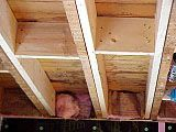 Sistering joists from below. We've done it under the dining room, amazing difference in our old house.