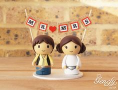 Han Solo and Leia wedding cake topper with Mr and Mrs bunting. https://www.facebook.com/genefyplayground