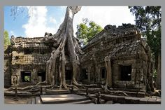 Ta Prohm is the modern name of a temple at Angkor, Siem Reap Province, Cambodia, built in the Bayon style largely in the late and early centuries and originally called Rajavihara. Ta Prohm, Abandoned Houses, Abandoned Places, Nevada, Photos Rares, Underwater City, Giant Tree, Buddhist Temple, Cambodia
