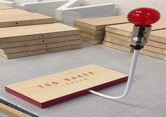 Ted Baker shoe Riser screen printed wood with lightbulb retail display