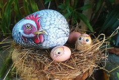 Mother hen, chicks, stone paintings by Ernestina