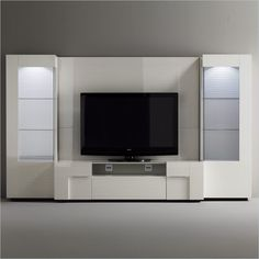 Rossetto Domino Home Theatre in Ivory - Choices of form and design combine together different precious materials to make a captivating home theatre system. Features: Includes the followings components: TV unit, back panels (2), right and left curios, and light kits (2) Made in Italy Warranty: 1 year manufacture defect