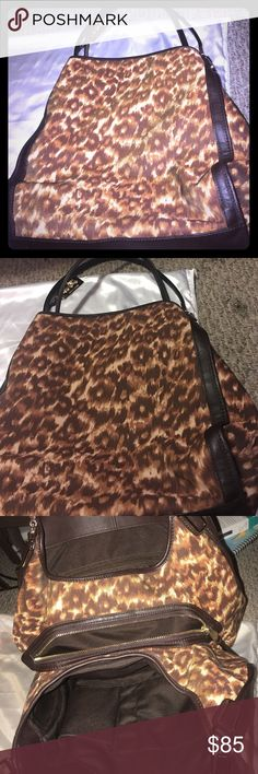 Coach leopard small Madison bag Super cute worn maybe three times in fantastic condition! Three compartments plenty of room. Brown leather straps and detail. Fun bag! Coach Bags Shoulder Bags