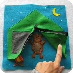 Busy book page. Camping. Zips open and shut. This pattern has a bear inside the tent. I would do a little boy or girl instead.