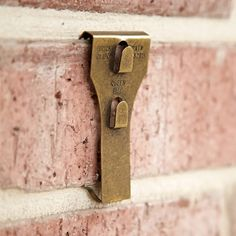 Brick Clips allow you to hang things on brick without drilling or damaging the brick.