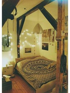 Love the beam! It makes the bed look like a cozy nook