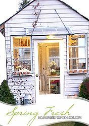 the garden house was made from recycled and reclaimed materials - tin roofing, old windows
