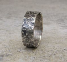Band Hammered Silver Ring Distressed Circles $53.00, via Etsy.