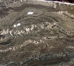 Smokey Mountain Granite Is Quarried In A Boulder Quarry In Brazil. It Is A  Beautiful, Rich Granite With Lots Of Movement/ Veining.