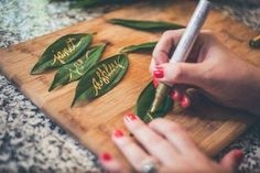 DIY Table Cards on Leaves Idea: Add small, eco-friendly touches to your boho wedding reception by using handwritten leaves as your table cards. Check out more ideas on our June Weddings site and make a date every Saturday night 9/8c with an original Hallmark Channel movie about love! #juneweddings #ecofriendly
