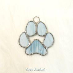 dog paw print - would make a good holiday ornament